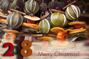 Winter holidays greeting card for 2017 to come. Descrete Blurry background with seasonal winter spice decorations.