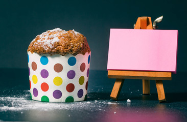 homemade muffins in colorful holders on the day of the birthday celebration. Kapka for children and women. blank sheet for writing your text