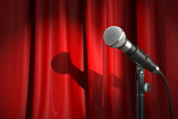 Microphone on stage with red curtain. Music or performance  conc