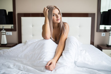 Young beauty girl wake up  mood in the morning in her bed at home