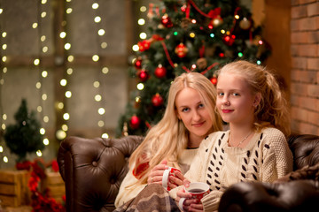 christmas and family concept - mother and daughter
