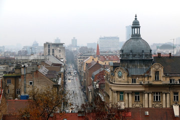 Historic architecture in Zagreb city centre during rainy, foggy day. View from Upper Town. Zagreb is a capital of Croatia.
