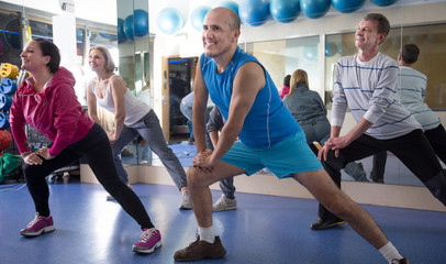 group of mature  people involved in sports gym