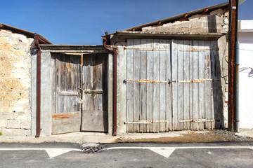 Old wooden facade doors in cypriot village Omodos.