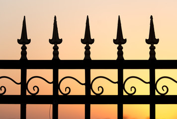 metal fence at sunset