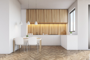 Kitchen counter top with light wood furniture