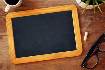 top view image of blank chalkboard next to cup of coffee