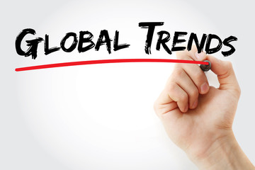 Hand writing Global trends with marker, concept background