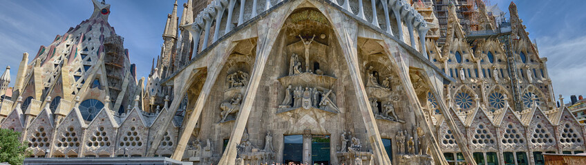 Detailed panoramic view on the bottom part of Sagrada Familia in Barcelona, Spain