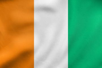 Flag of Ivory Coast waving, real fabric texture