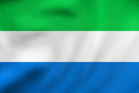 Flag of Sierra Leone waving, real fabric texture