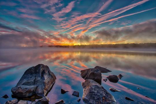Foggy pre-sunrise skies over the lake in Nockamixon State Park located in Bucks County Pennsylvania.