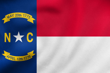 Flag of North Carolina waving, real fabric texture
