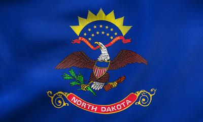Flag of North Dakota waving, real fabric texture