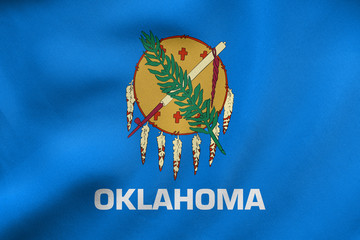 Flag of Oklahoma waving, real fabric texture