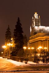 Main building of the Lomonosov Moscow State University. MGU. The Sparrow Hills, Moscow, Russia. Entry group. Winter. Night view.