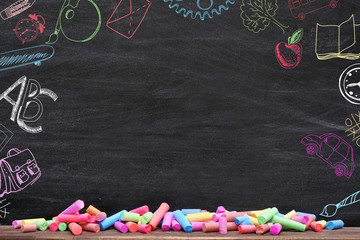 Creative sketches on chalkboard background. Children development concept.