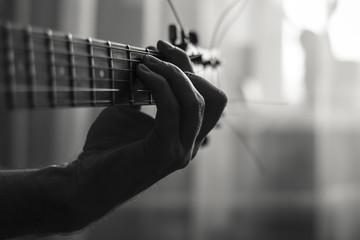 Playing guitar black and white