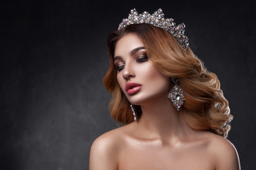 Beauty woman with beautiful make-up color, crown on his head  .