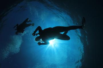Scuba divers diving