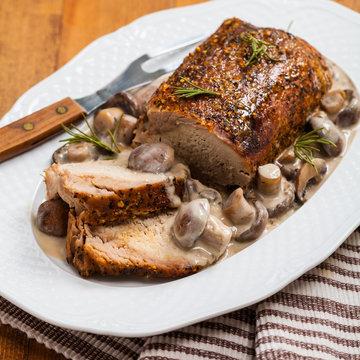 Roasted Pork Loin Tenderloin with Mushroom. Selective focus.