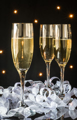 Champagne flutes with bubbly