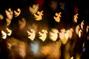 Blurred lights bokeh background of angels