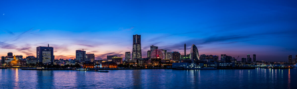 Wide panorama of Yokohama Minato Mirai 21 seaside urban area in Japan at dusk