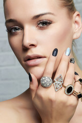beauty face.woman's hands with jewelry rings.close-up beauty and fashion girl,manicure