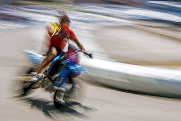 Blurred motion motorcyclist