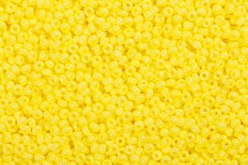 Many yellow glass beads.