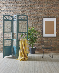 yellow wrap paravane frame and black chair with brick wall