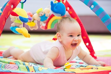 Sweet Baby Crawling And Playing With Toys