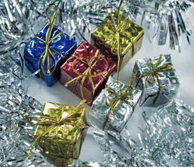 Vintage Christmas gifts toned photo. Blue, red, gold and silver wrapped presents for Christmas