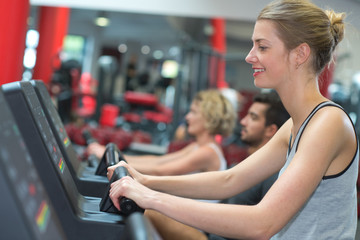 smiling woman running on a treadmill