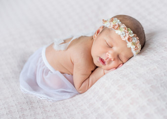 lovely newborn girl sleeping on her stomach