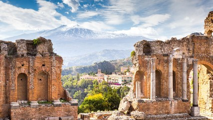 Ruins and columns of antique greek theater in Taormina and Etna Mount in the background. Sicily, Italy, Europe. Wall mural