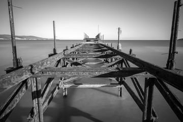 Old iron bridge in sea