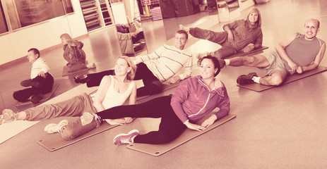 Adults doing pilates routine