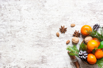 christmas food background. tangerines. pine cones, nuts and spices