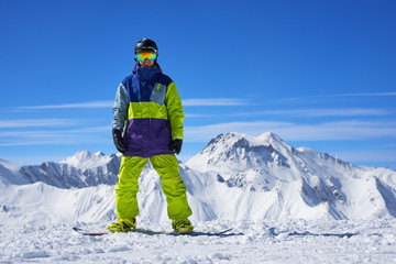 snowboarder standing on the top of a mountain