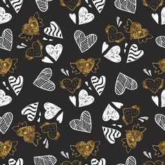 Golden seamless pattern with the image of tribal hearts