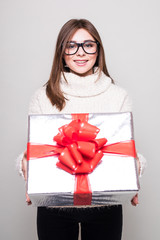 young woman in sweater with small gift