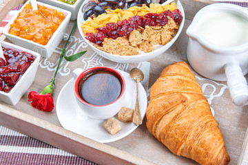 French breakfast on a wooden tray