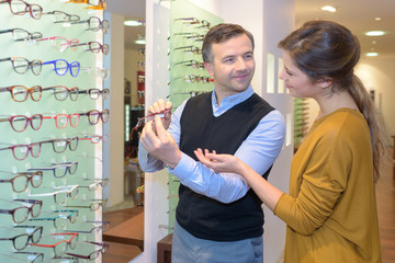 optician holding an eyeglasses