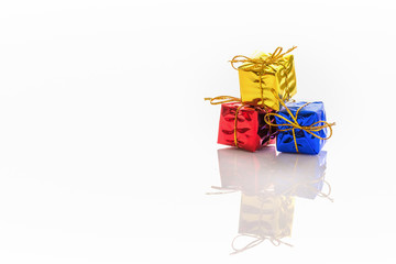 Gift box on white background. For adorn greeting cards.