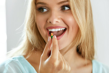Beautiful Woman Taking Pill, Medicine. Vitamins And Supplements