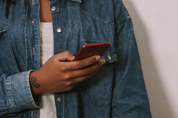 closeup of the hands of the girl young with jeans with the phone mobile