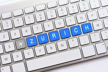 ZURICH writing on white keyboard with a aircraft sketch