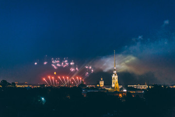 """Fireworks over the city of St. Petersburg (Russia) on the feast of """"Scarlet Sails"""", in the rain with fog and smoke."""